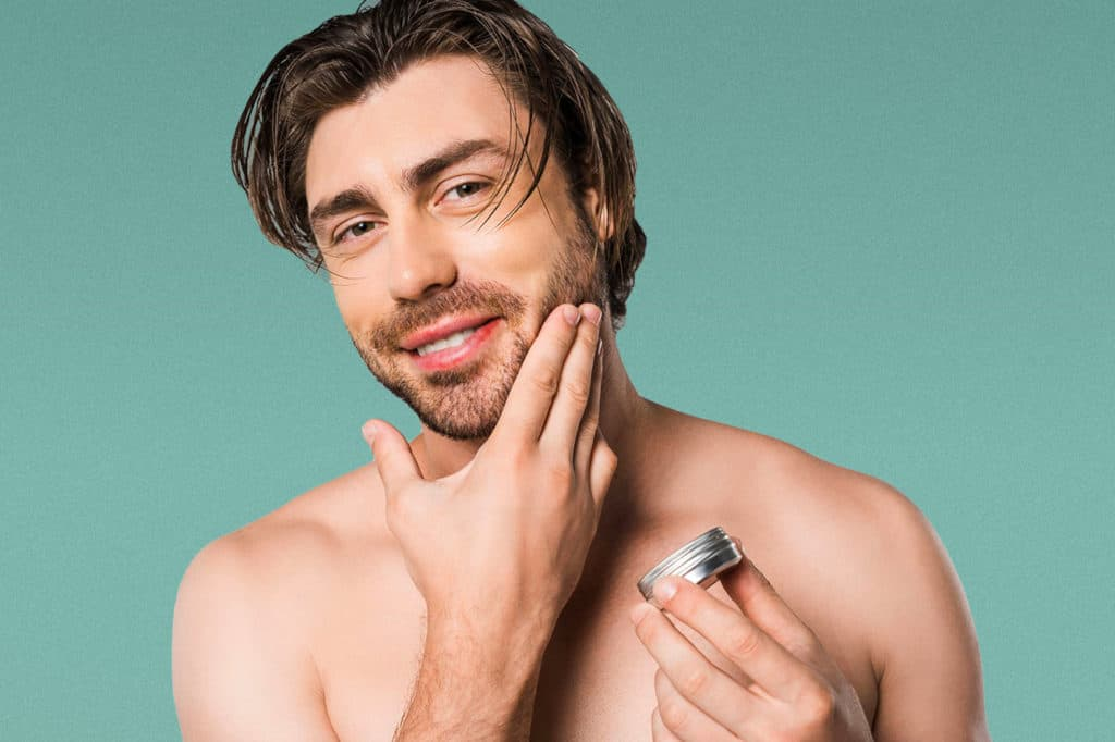 Man using an aftershave balm