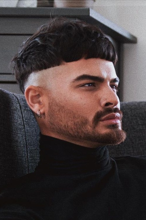 Man with Ceasar cut hairstyle