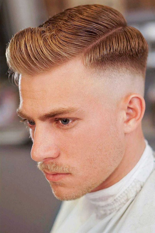 Man with Short Low Bald Fade w/ Side Part