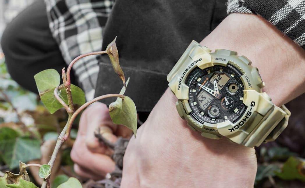 Man wearing a green sports watch