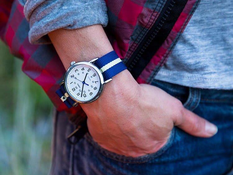 Man wearing a blue stiped watch