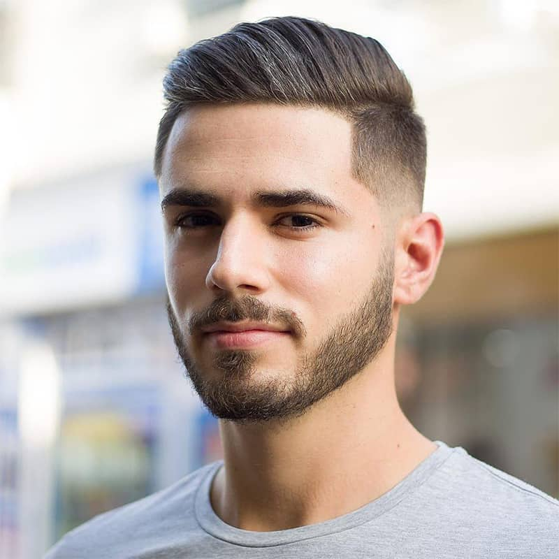 handsome man with comb over fade haircut
