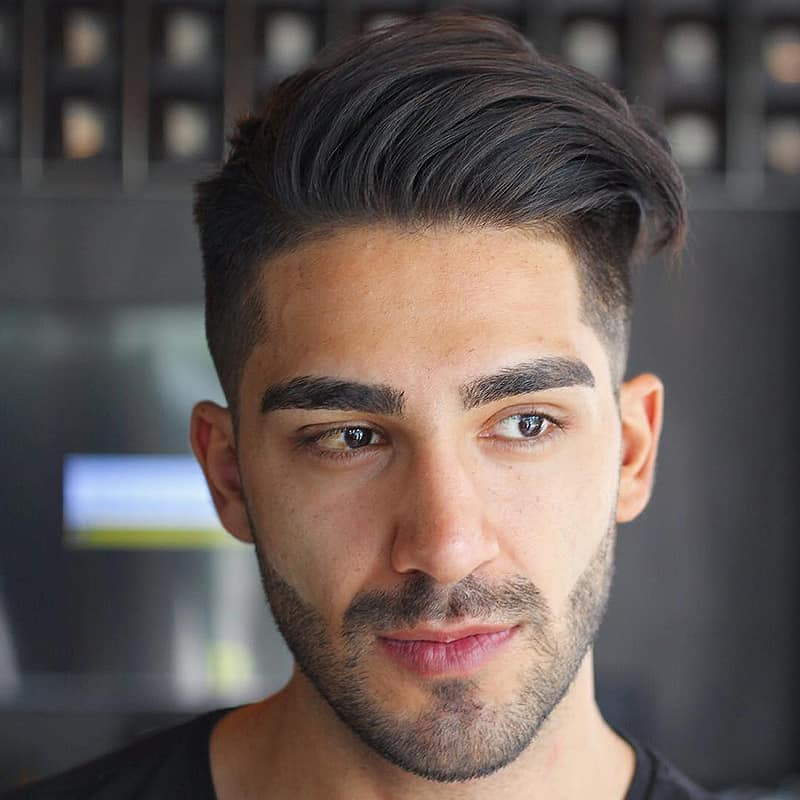 handsome man with taper fade comb over
