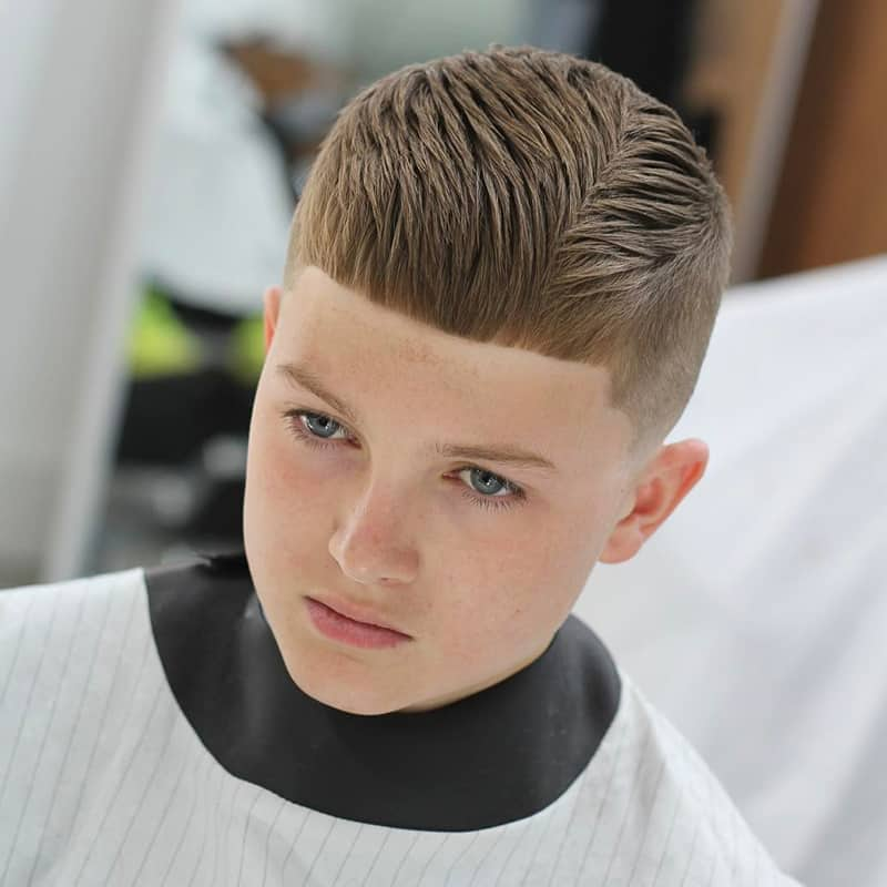 handsome young boy with side angle comb over