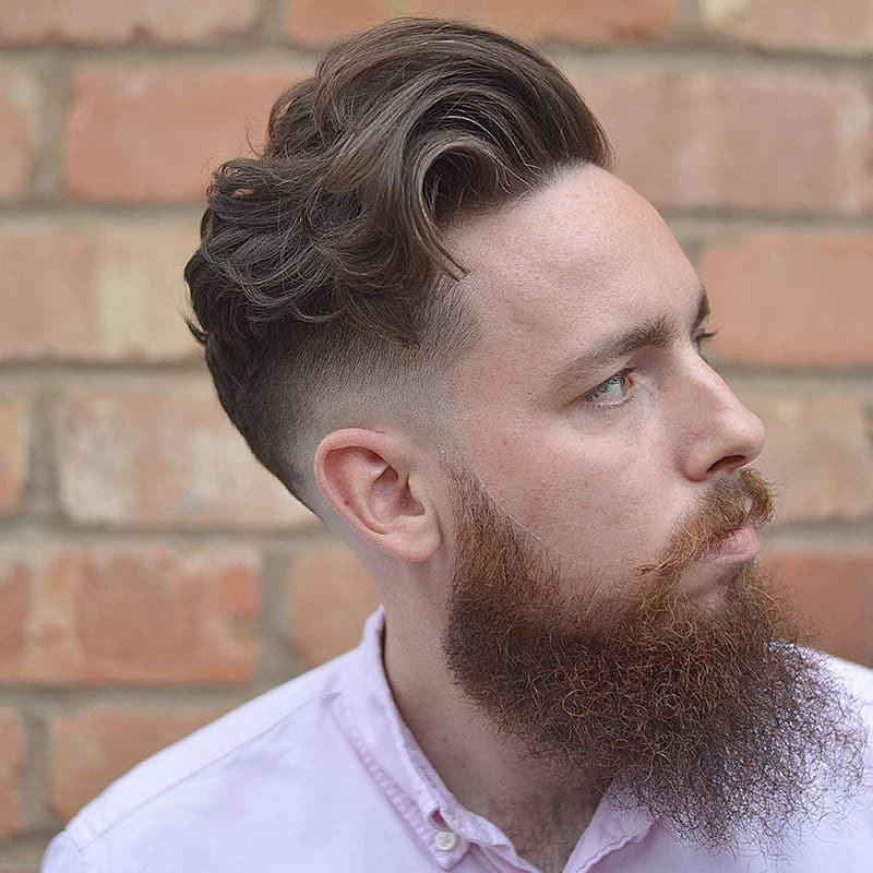 handsome man with wavy comb over