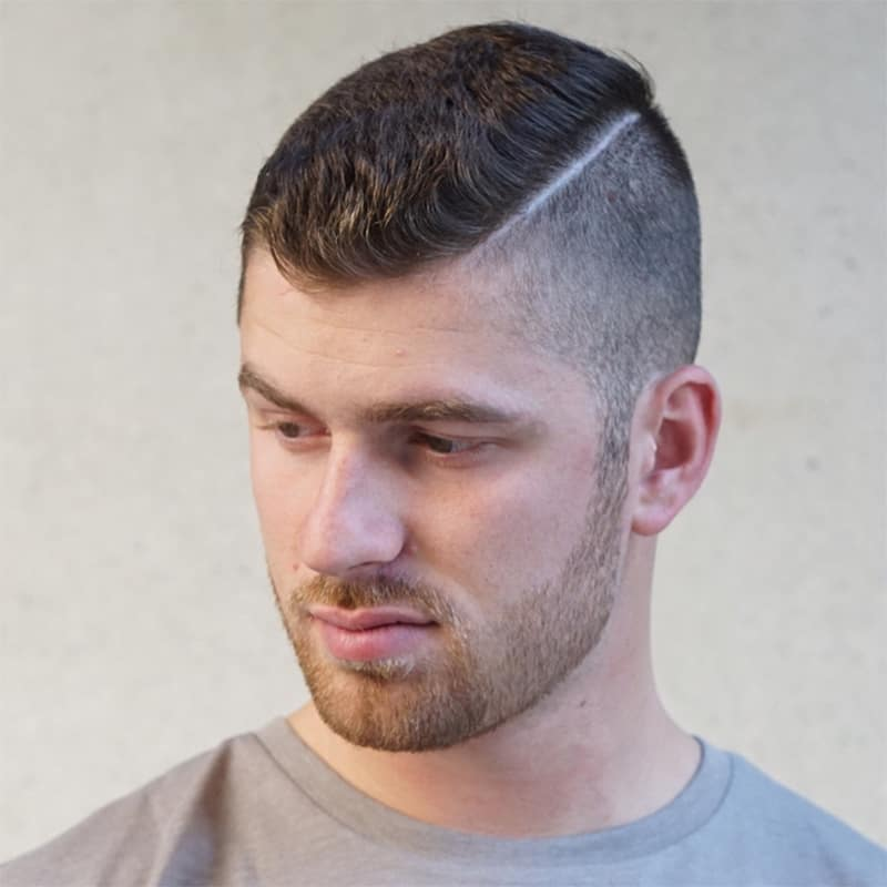handsome man with tight crop comb over