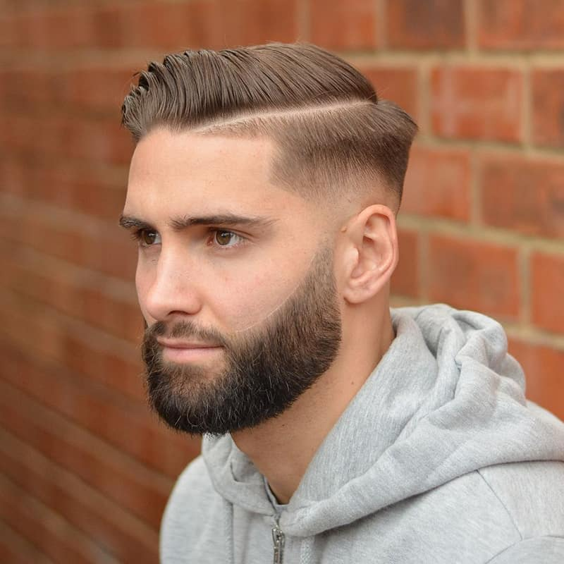 handsome man with side short sweep comb over