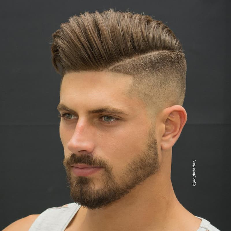 handsome man with burst fade comb over