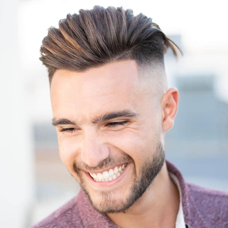 Handsome man with pompadour comb over