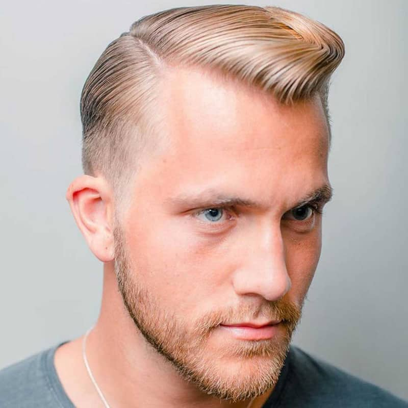 handsome man with medium taper pomp comb over