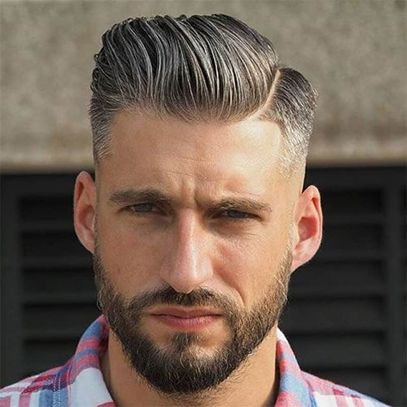 handsome man with clean cut comb over