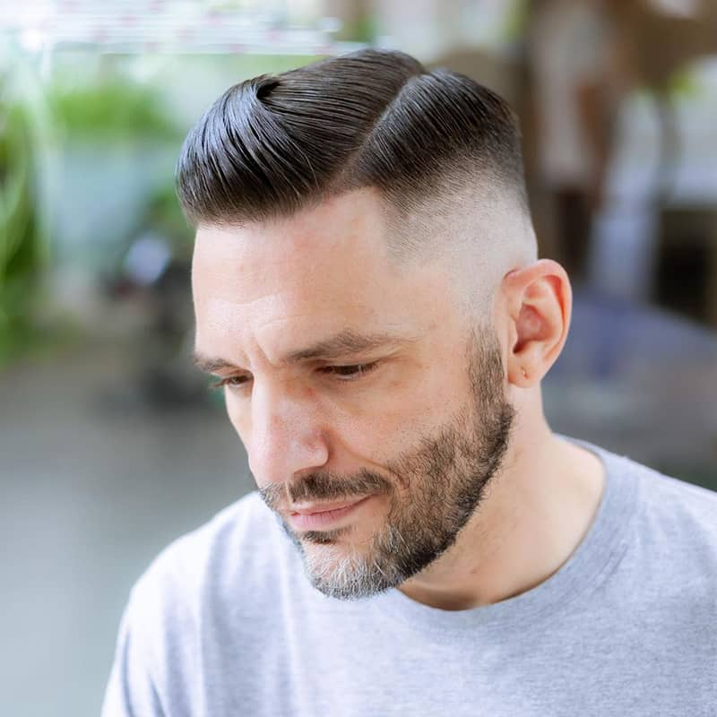handsome man with high fade comb over