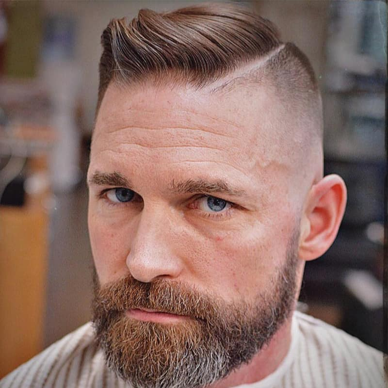 handsome man with short comb over