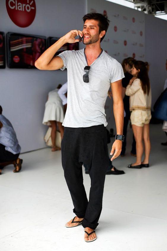 Man wearing pants and flip flops