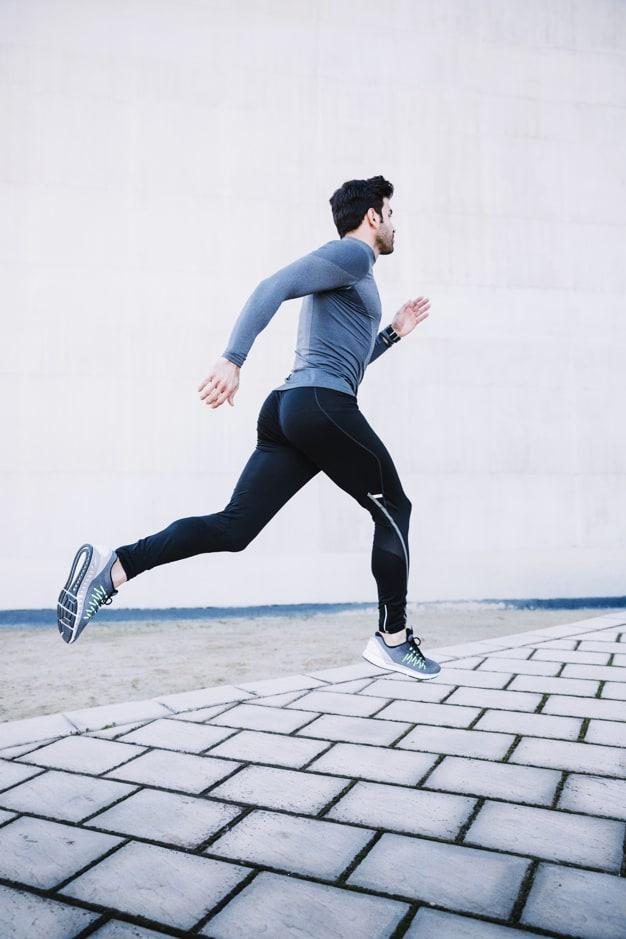 Man running with a long sleeved running shirt
