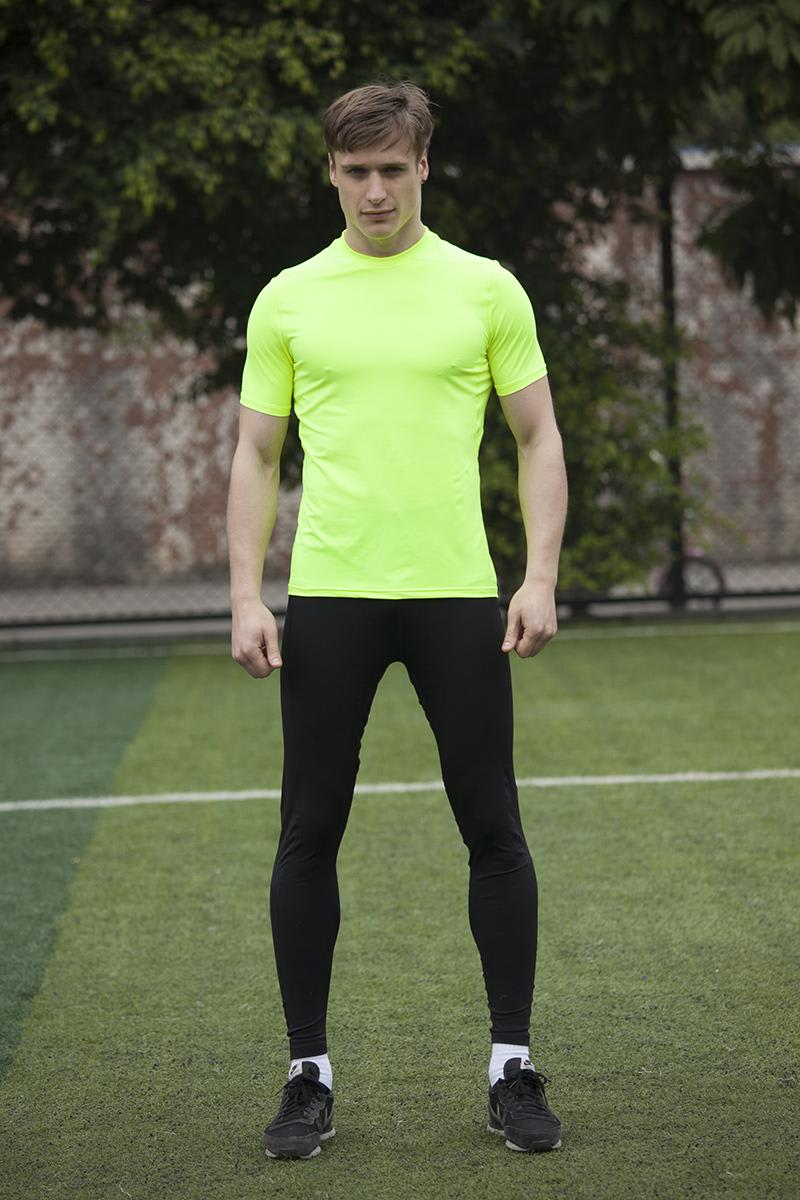 Man wearing a neon green nylon running shirt
