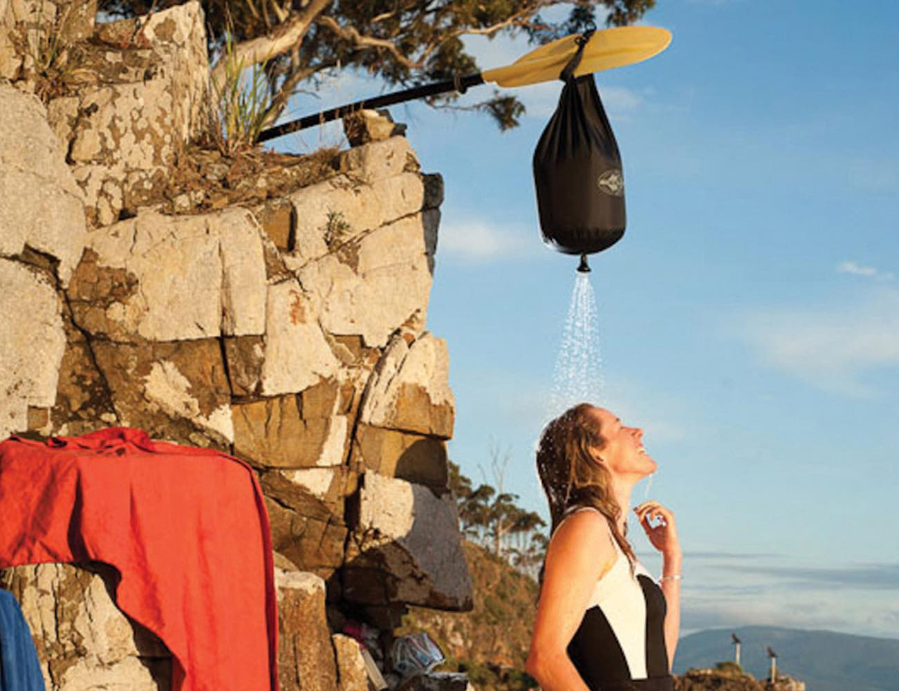 woman using a camping shower