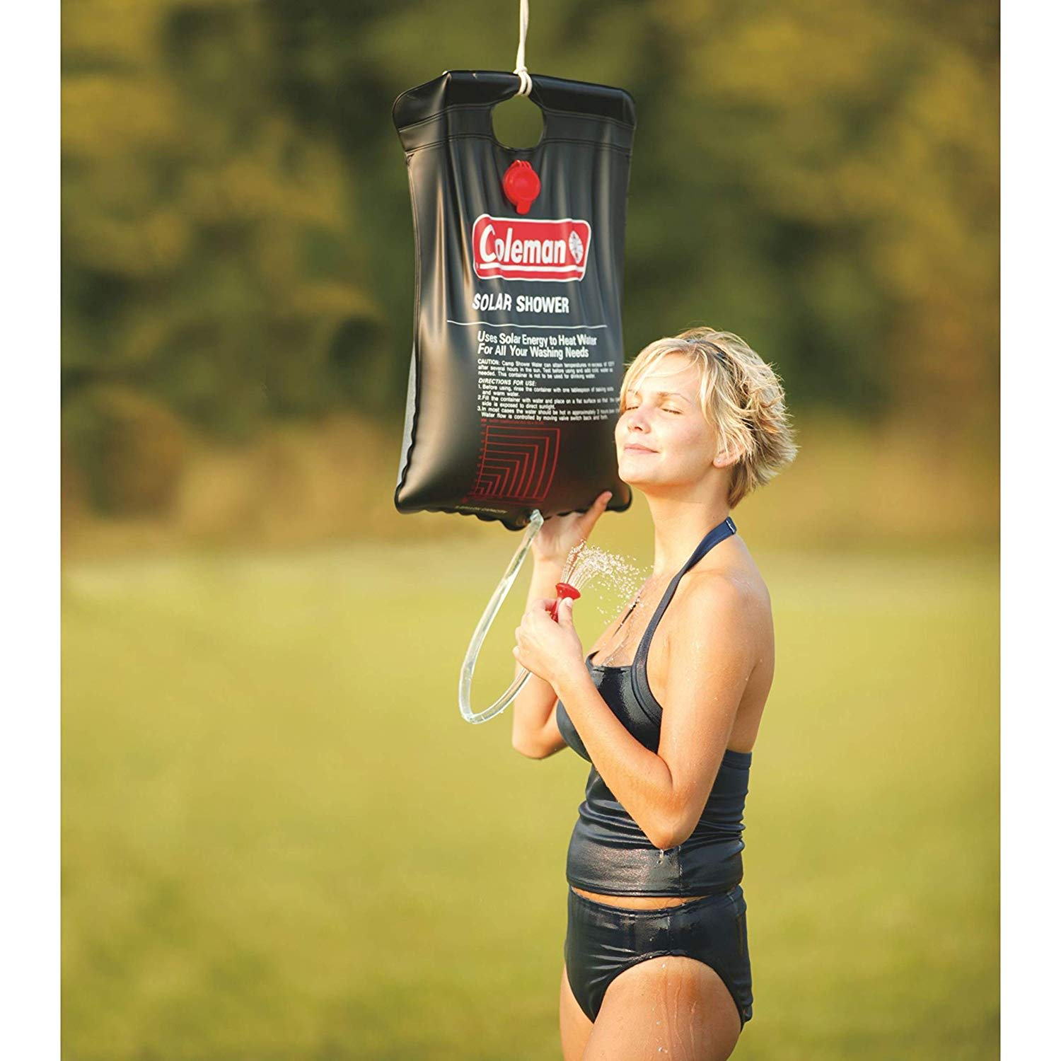 woman using a portable camping shower