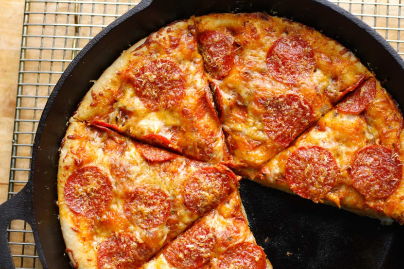 slices of pizza on a skillet