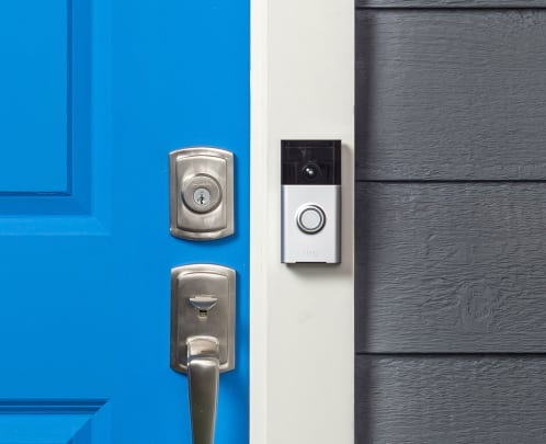 doorbell camera beside a blue door