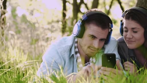 man and woman using a headphone