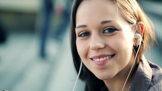 woman using an earbuds outdoor