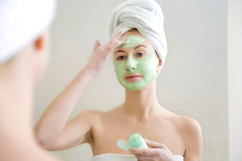 woman applying a face mask