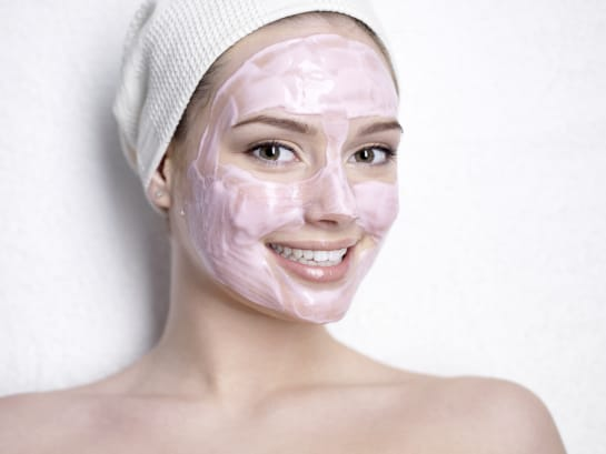 woman with a pink face mask on her face