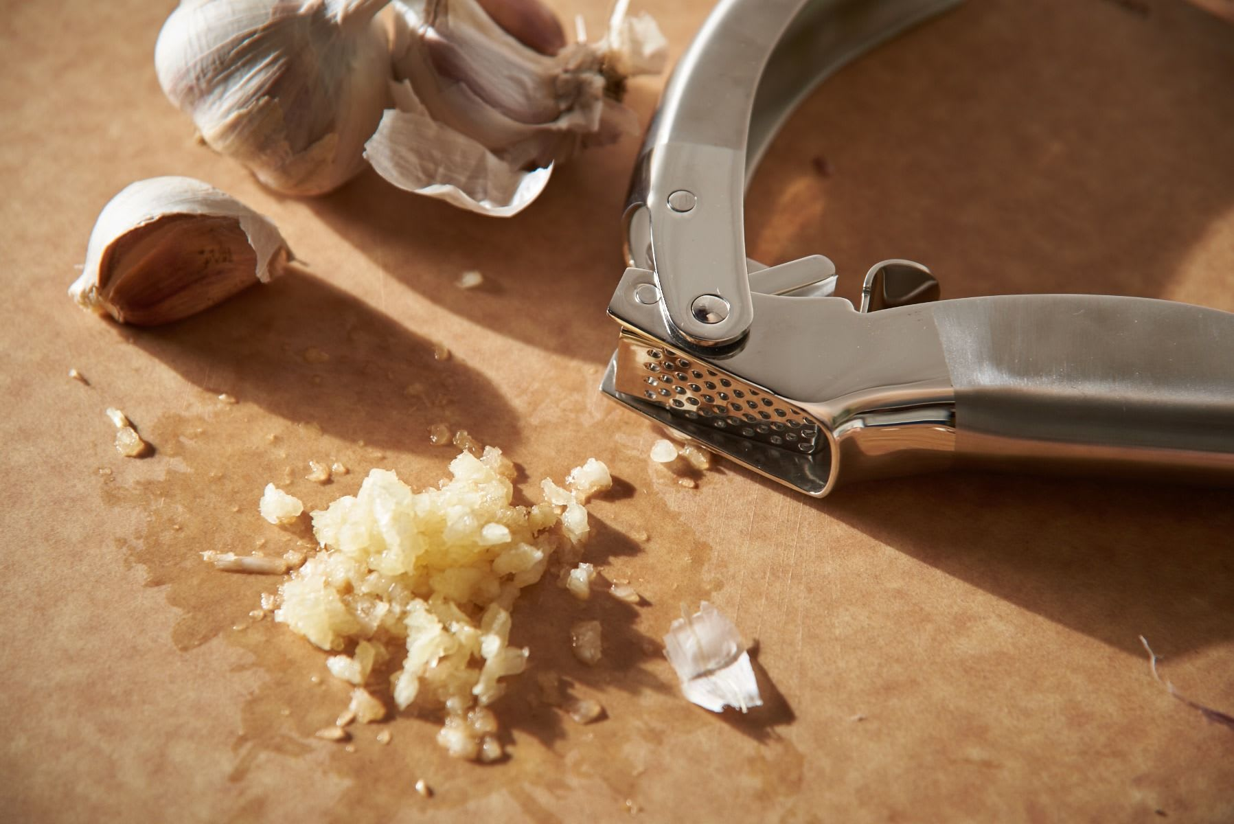 garlic press and garlic