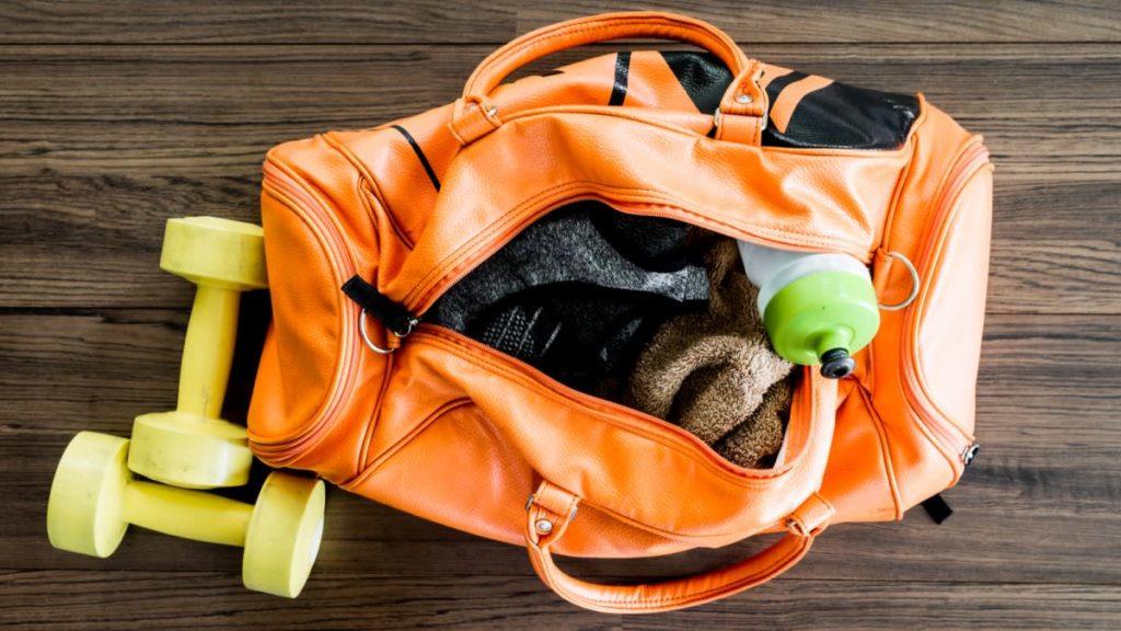 orange gym bag full of equipment