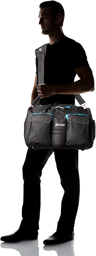 man standing with a gym bag on his shoulder