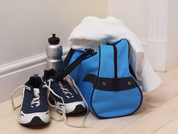 blue gym bag, pair of shoes, and a water bottle