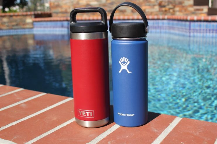 two hydro flasks beside a pool
