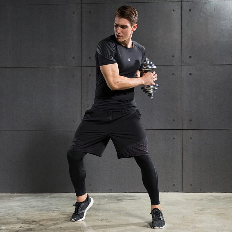 man wearing a tight fit compression pants while working out
