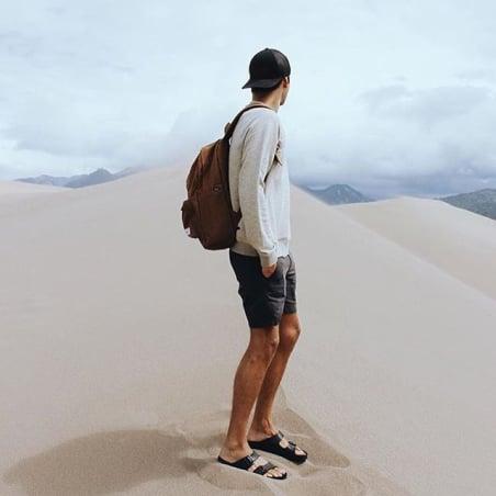 man wearing sandals at the desert