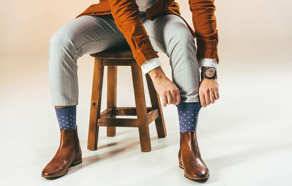man wearing a pair of blue socks