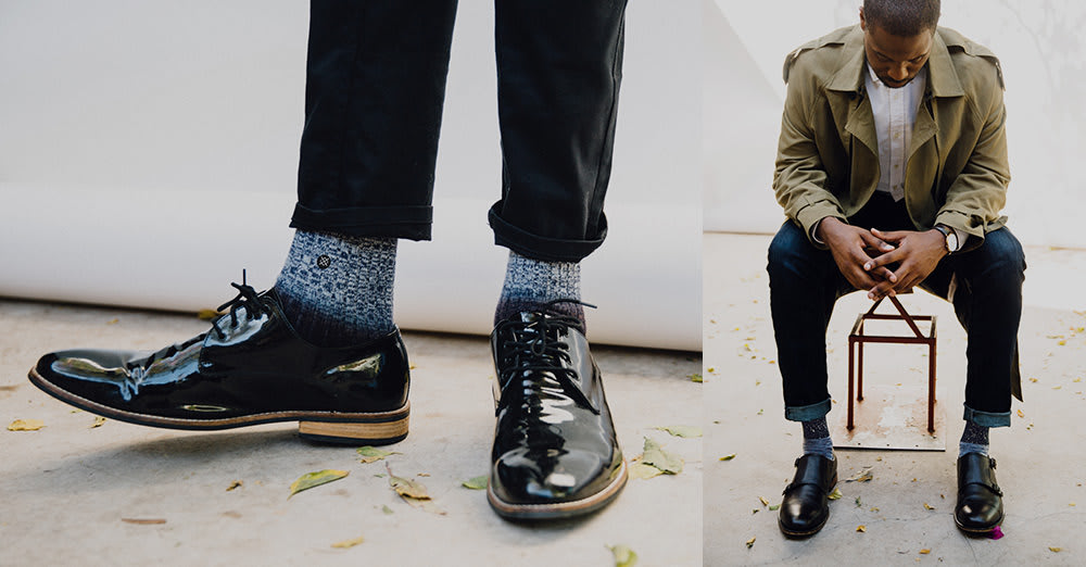 man wearing socks pair with cuffed jeans