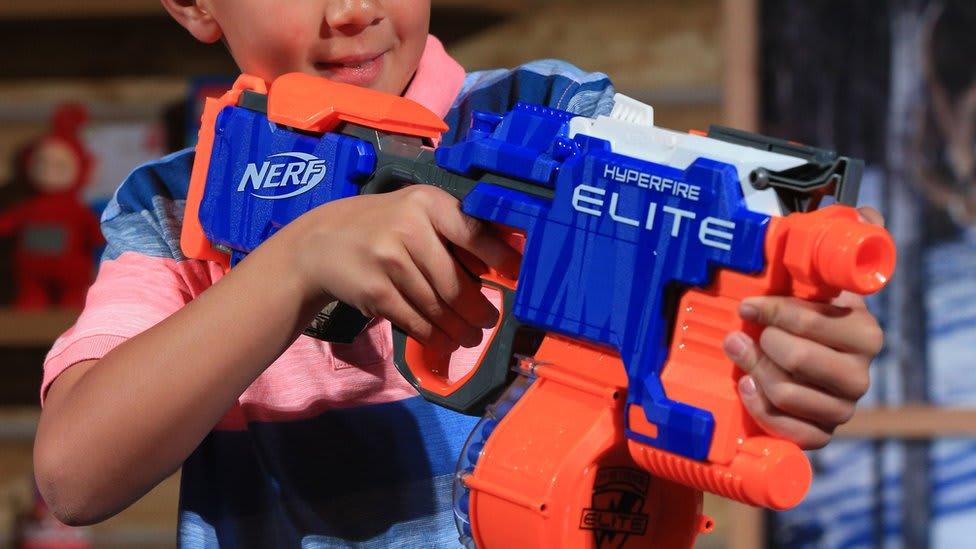 boy holding a nerf gun