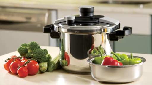 pressure cooker and bowl of vegetables