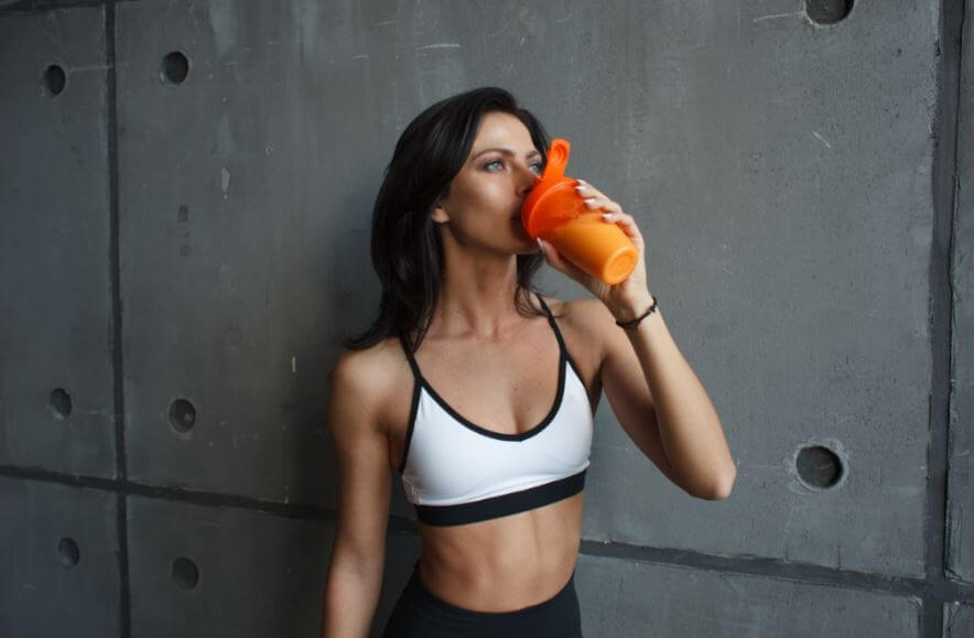 woman drinking a protein powder drink