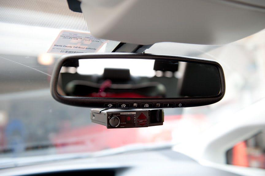 rear mirror mounted with a radar detector
