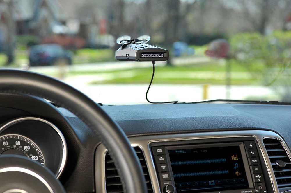 radar detector attached at the front of a car