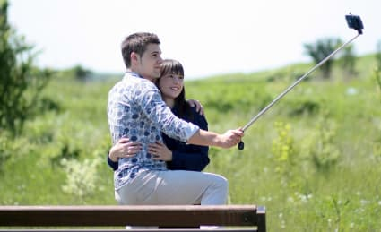 couple using a selfie stick to take a picture
