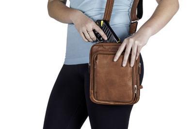 man with a stun gun in his bag