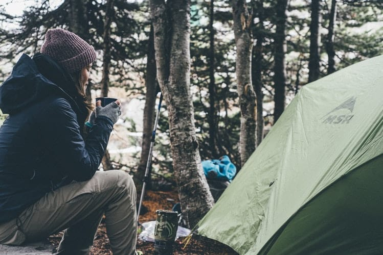 drinking coffee outside the camping tent