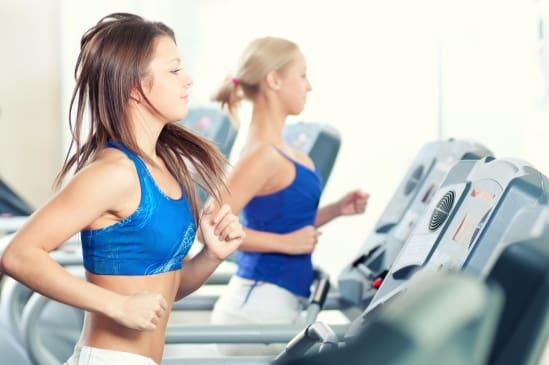 women on running on a treadmill