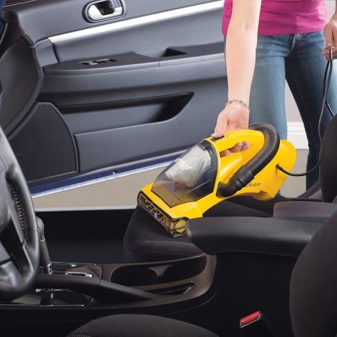 vacuuming a car