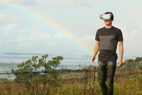 man using a virtual reality headset outdoors