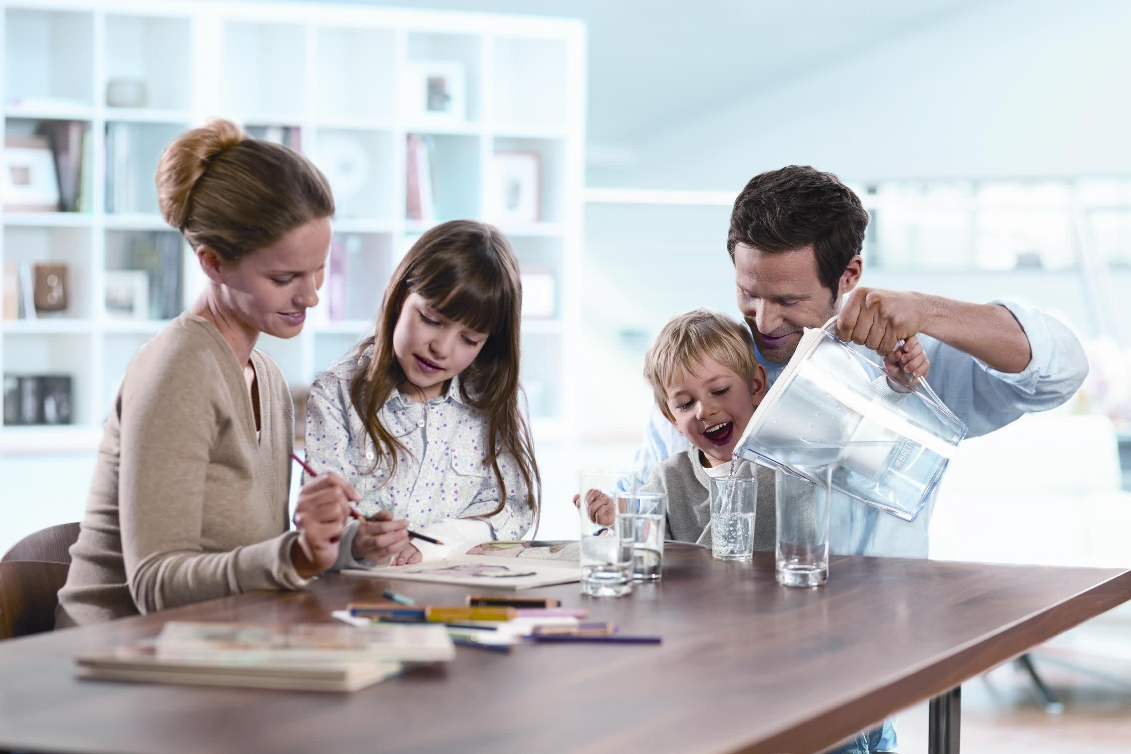 family on the dining table with water on a pitcher