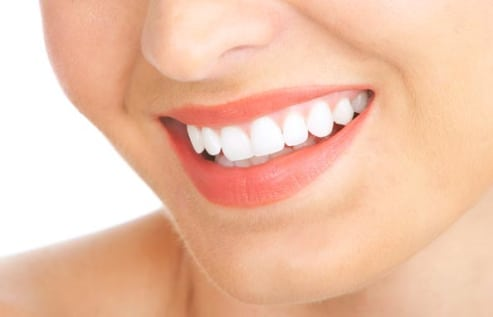 woman smiling with a white teeth